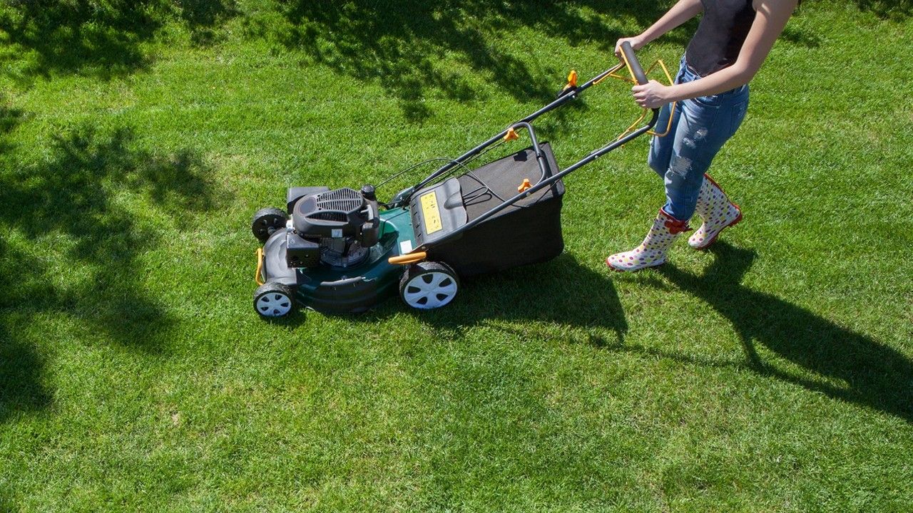woman using a lawn mower