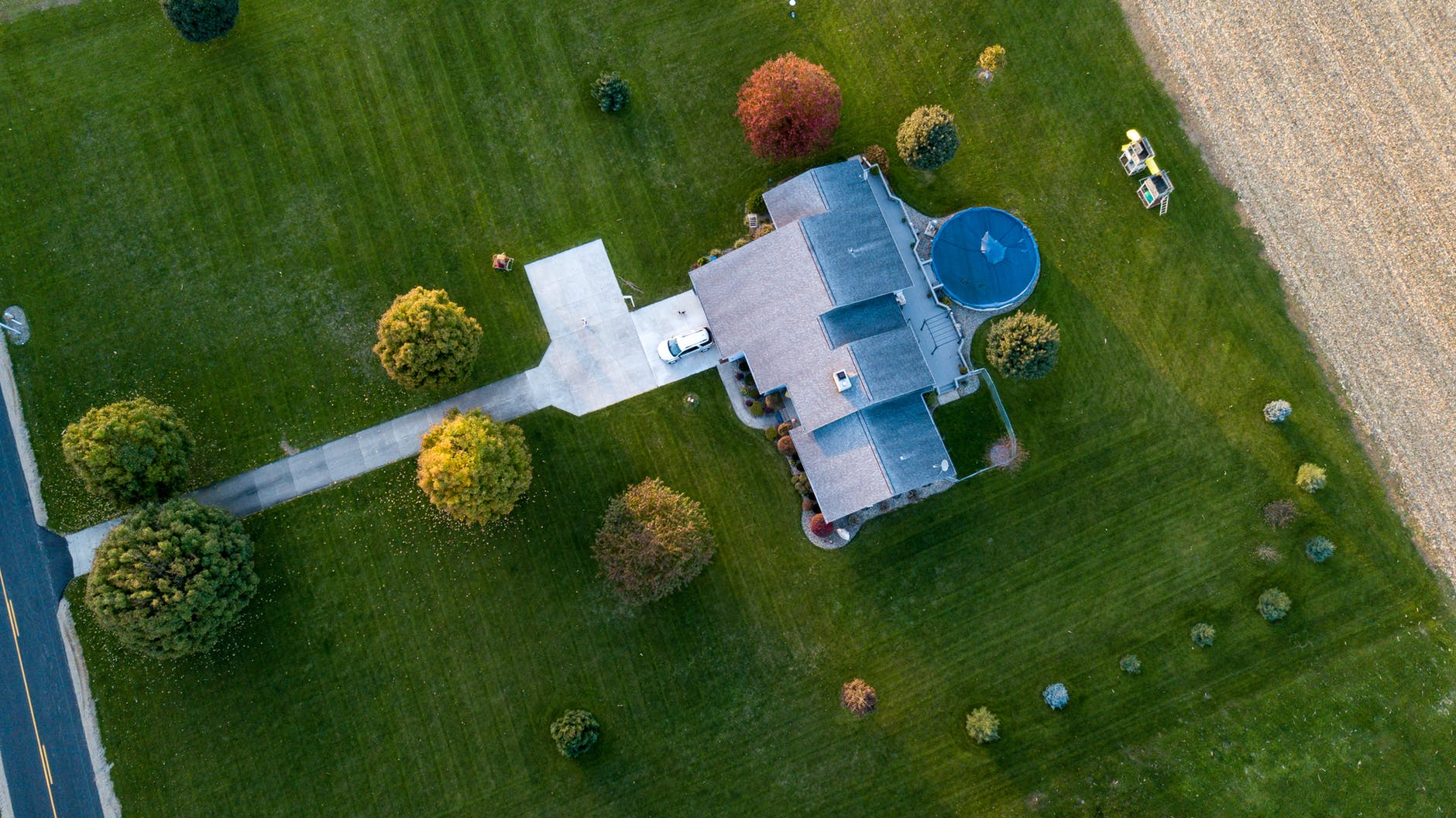 aerial view of a house with a large lawn area